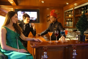 "Just like this couple enjoying cocktails in the Rajah Club, ""The Indian Splendor"" rail tour on the Maharajas' Express is a great choice for your next romantic getaway!"