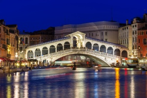 Night view of Rialto bridge and Grand Canal in Venice. Italy
